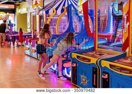 Mackay, Queensland Australia - February 2020: Two Young Girls Playing A Game In An Amusement Arcade