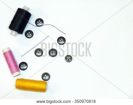 Sewing And Needlework. Sewing Background. Sewing Tools In Close-up Isolated On A White Background. T