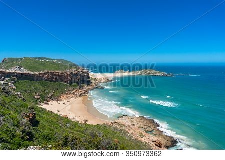 Summer Seaside Landscape With Sandy Beach And Grassy Hills. Beautiful Coastal Landscape With Beach