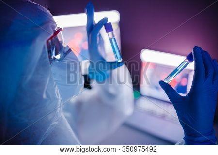 Medic In White Hazmat Protective Research Scientist Work Online Computer Blood Test On Slide In Mode