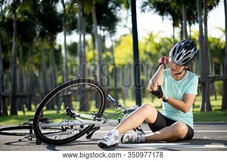 Bike Injuries. Woman Cyclist Fell Off Road Bike While Cycling. Bicycle Accident, Injured Elbow.
