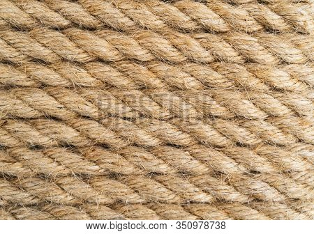 Background Twisted Rope. Rope Texture. Brown And Yellow Rope Texture. Old Vintage Sailboat Rope.