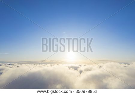 Aerial View White Clouds In Blue Sky. Top Fly. Looking From The Drone. Aerial Bird's Eye View. Aeria