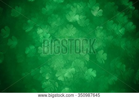 Clover Shaped Bokeh. St.patrick S Day. Blurred Abstract Background. Green Shamrock