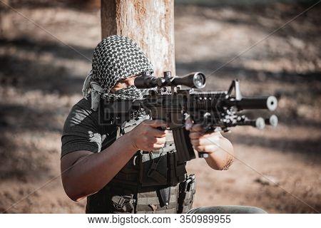 Man Terrorist Wearing A Mask And Holding A Gun, Terrorist Concpet