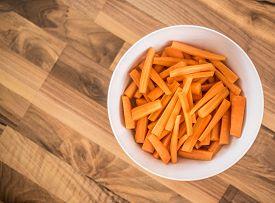 Carrot Sticks In A White Bowl - Healthy Root Vegetable Full Of Vitamin K, Alfa- And Beta-carotene