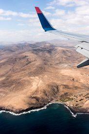 Canary Islands mountain landscape under airplane wing