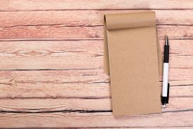 Blank Notebook With Pen On A Wooden Table, Business Concept Concept Of A New Workplace