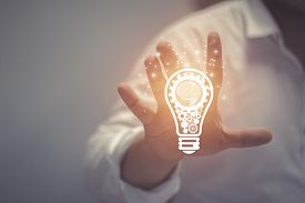 Business Idea And Vision, Businessman Holding Light Bulb, Concept Of New Ideas, Innovation, Inventio