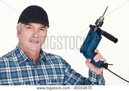 Elderly man holding an electric screwdriver