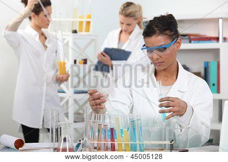 Women conducting an experiment