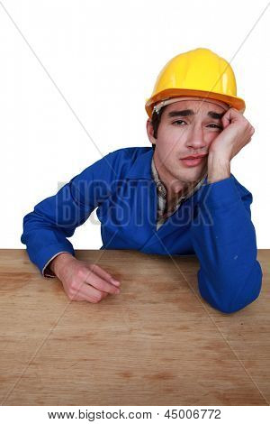 young craftsman with sulky expression