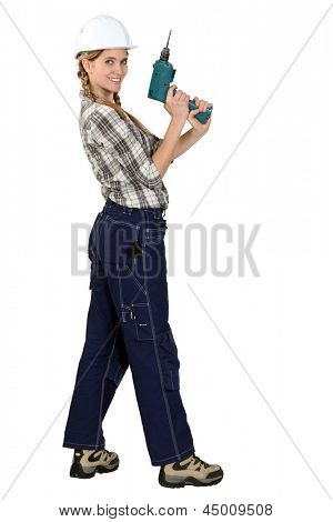 Tradeswoman with electric screwdriver