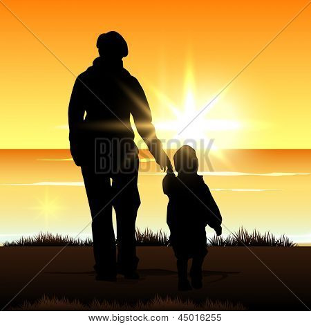 Silhouette of a mother with her child on evening background.