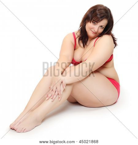 Overweight woman dressed in bikini.