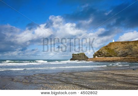 Atlantic Clouds Over Portreath Pier And The Pepperpot, Cornwall Uk