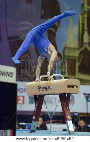 MOSCOW, RUSSIA - APRIL 20: Alberto Busnari, Italy performs exercise on pommel horse in final of 5th European Championships in Artistic Gymnastics in Moscow, Russia on April 20, 2013
