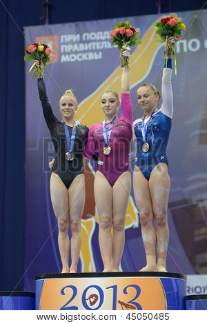 MOSCOW, RUSSIA - APRIL 20: Medalists on uneven bars in European Championships in Artistic Gymnastics in Moscow, Russia on April 20, 2013. Left to right Adlerteg, Sweden, Mustafina, Paseka, both Russia