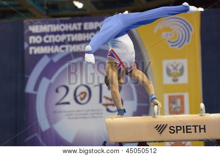 MOSCOW, RUSSIA - APRIL 20: Daniel Keatings, Great Britain performs exercise on pommel horse in final of 5th European Championships in Artistic Gymnastics in Moscow, Russia on April 20, 2013
