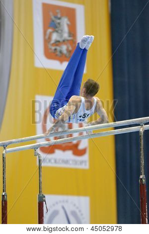 MOSCOW, RUSSIA - APRIL 21: Oleg Verniaiev, Ukraine performs exercise on parallel bars in final of 5th European Championships in Artistic Gymnastics in Moscow, Russia on April 21, 2013