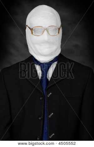 Businessman - mummy in spectacles on the black background poster
