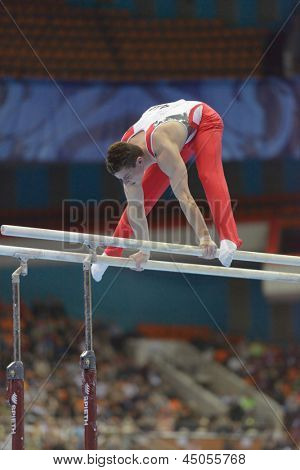 MOSCOW, RUSSIA - APRIL 21: Lucas Fischer, Switzerland performs exercise on parallel bars in final of 5th European Championships in Artistic Gymnastics in Moscow, Russia on April 21, 2013