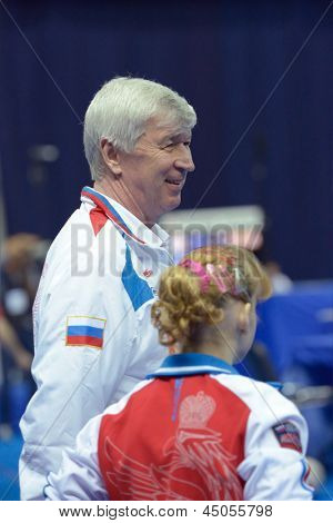 MOSCOW, RUSSIA - APRIL 21: Anastasia Grishina, Russia with her coach after exercise on balance beam in final of 5th European Championships in Artistic Gymnastics in Moscow, Russia on April 21, 2013