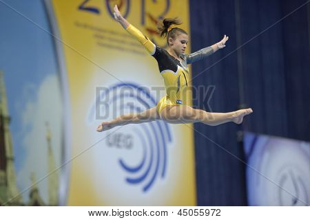 MOSCOW, RUSSIA - APRIL 21: Diana Laura Bulimar, Romania performs exercise on balance beam in final of 5th European Championships in Artistic Gymnastics in Moscow, Russia on April 21, 2013