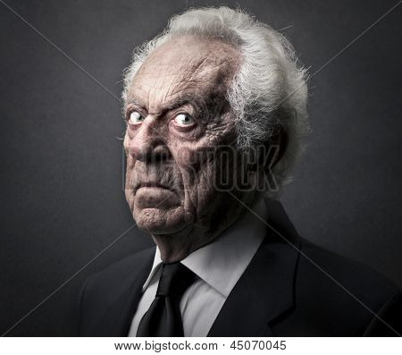 portrait of senior bad businessman poster