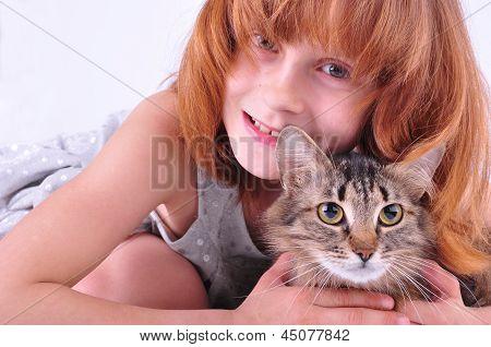 Little Girl Hugging Her Cat