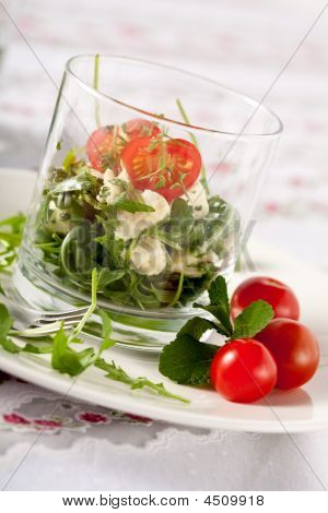 Small and healthy salad with feta rocket and mozarella poster