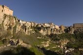 The medieval town of Cuenca is built on a rocky outcrop at the Hoz de Huecar a gorge formed at the join of the Jucar and Huecar rivers in La Mancha province of Spain poster