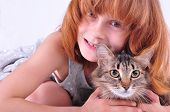 beautiful happy red little girl hugging her cat poster