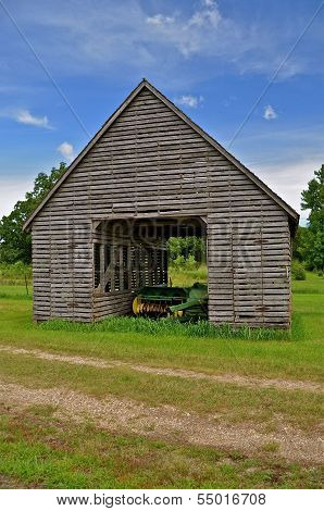 Antiquated corn crib is home to a baler