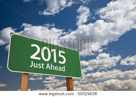 2015 Just Ahead Green Road Sign Over Dramatic Clouds and Sky.