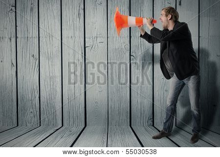 A Man Uses A Warning Cone As A Megaphone