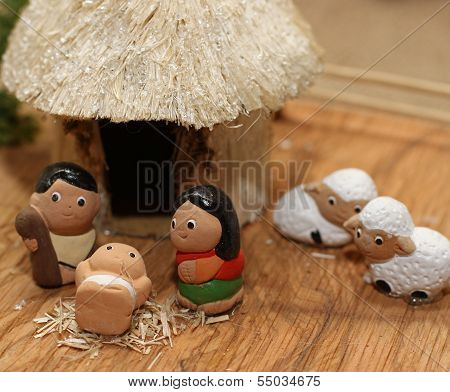 Miniature Nativity Set With The White Sheep And The Holy Family