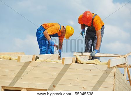 Two construction carpenters roofers workers installing wood board roof poster