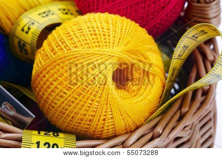 Knitting And Tape On The Background Of Baskets
