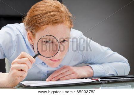 Strict Businesswoman Analyzing Documents
