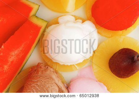 watermelon plum and slice of pineapple and chocolate and fruit ice cream on white plate isolated over white background