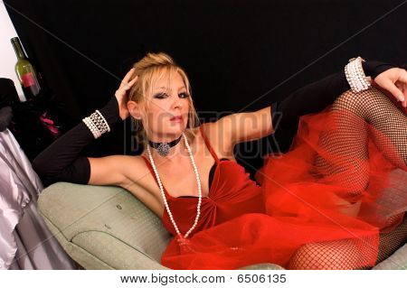 Blonde Sitting Wearing Fishnets