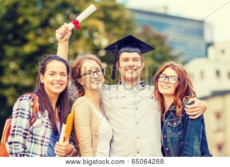 education, campus and teenage concept - group of students or teenagers with files, folders, eyeglasses and diploma
