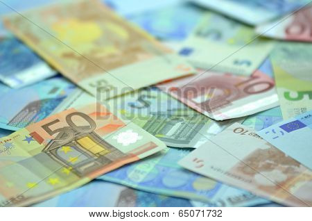 a variety of different euro banknotes lying on the table poster