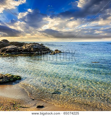 Calm Sea With Waves On  Sandy Beach