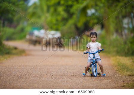 Cute Girl Riding Her Bike