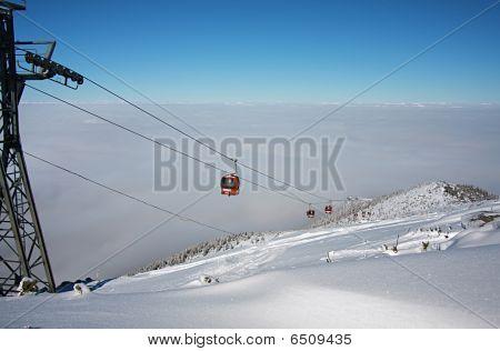 Cable Car Ski Lift Over Mountain Landscape