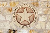 Texas Department of Transportation Symbol on the Sandstone Wall poster