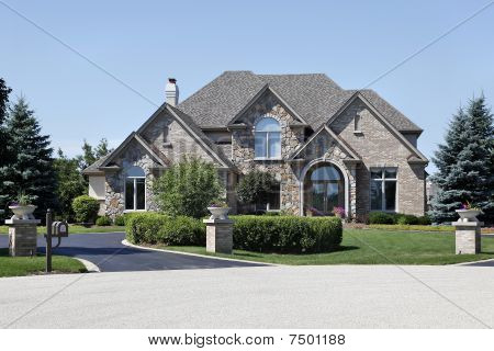 Brick And Stone Home With Cedar Roof