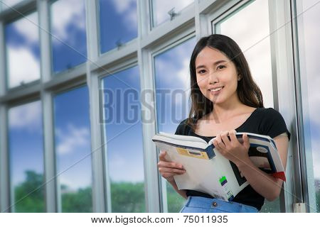 Young woman read a book